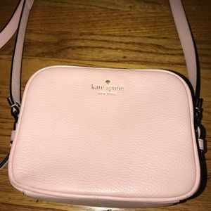 Light pink Kate Spade crossbody purse.